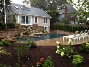 gardening and waterfall around pool