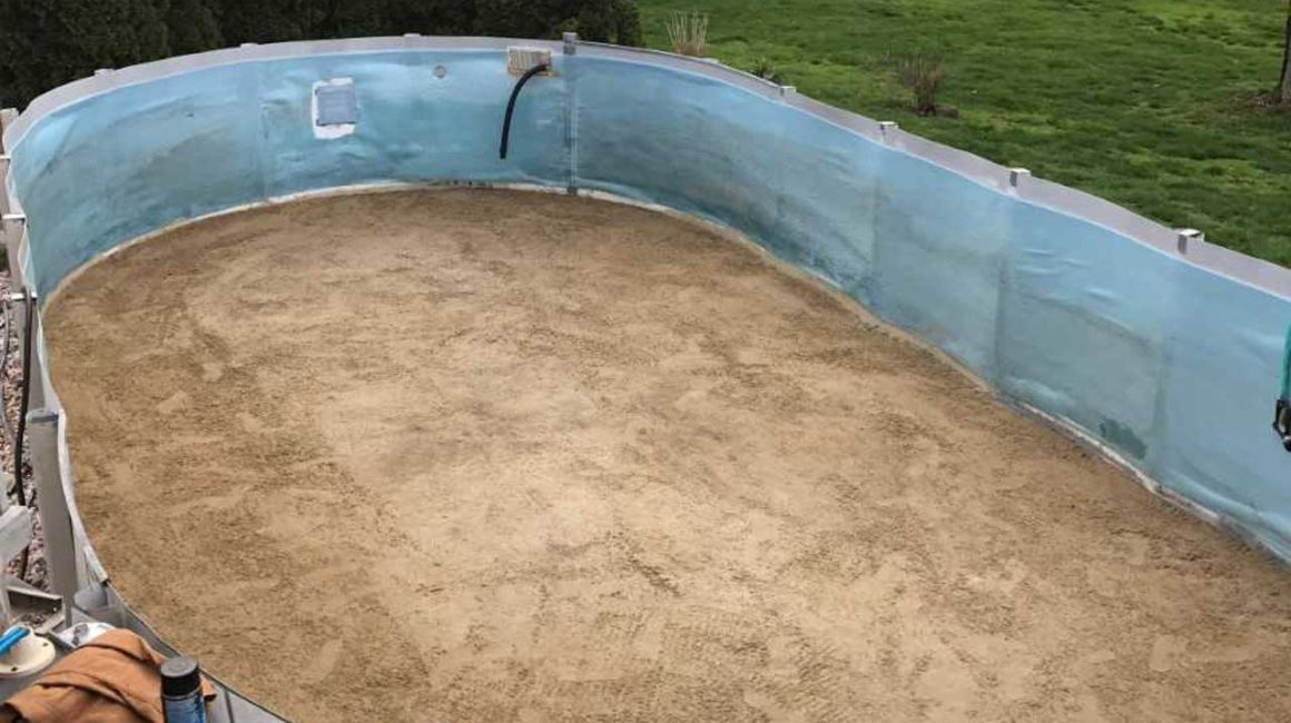 empty above ground pool being renovated