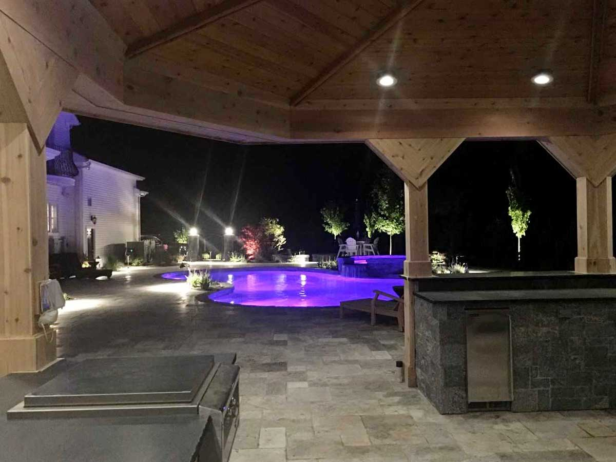 outdoor kitchen and pool lights at night