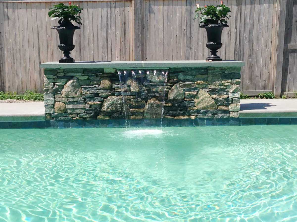 pool waterfall with masonry